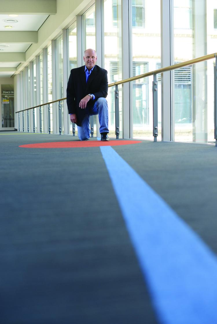 John Becker, CEO of Floors by Beckers, at its carpet installation in Minneapolis' LaSalle Plaza