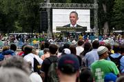 Participants listen to President Barack Obama's speech from the steps of the Lincoln Memorial.