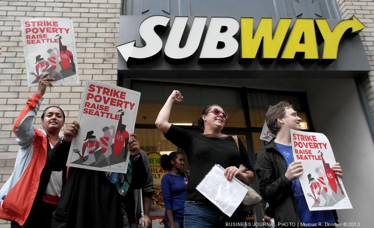 Demonstrators picket a Subway in Seattle during a national day of protests last year calling for an increase in the minimum wage.