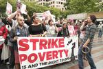 Protesters rally in Seattle for higher minimum wage (Video)