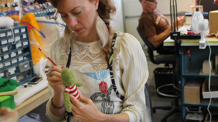 HouseSpecial's Margaret Meyer, a stop-motion costumer and painter, dresses a stop-motion puppet used on a holiday spot for Ohio Lottery. Tony Merrithew, in the background, sculpts an additional character used in the ad. Click through for more images from HouseSpecial's Portland studio.