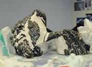 A scale model of a rock formation that resembles a penguin mother and child, which is the centerpiece of the Antarctica scenery