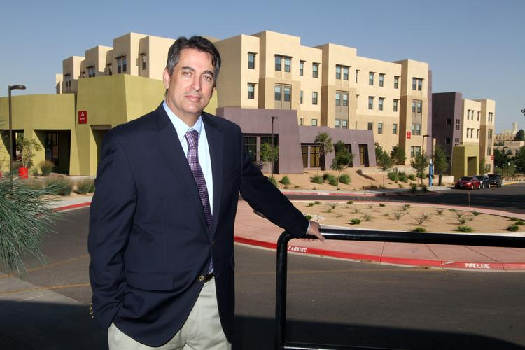 Tom Neale, interim real estate director at UNM, oversees eight full-time employees. He is pictured at Casas del Rio.