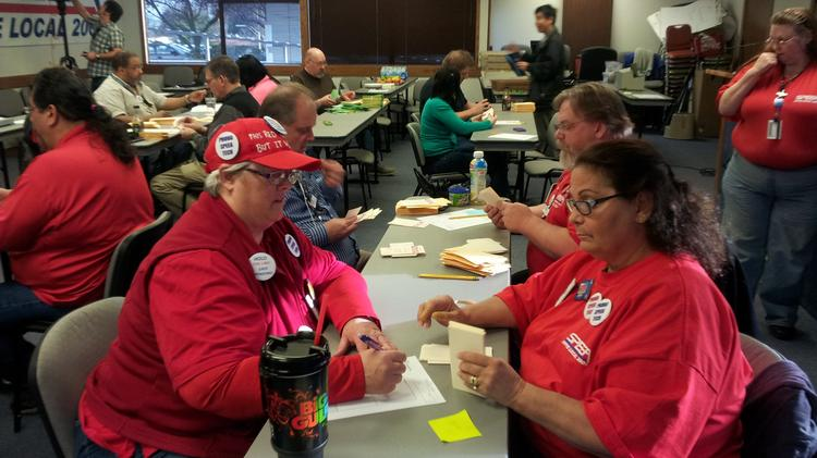 Members of Boeing's Society of Professional Engineering Employees in Aerospace (SPEEA) union count ballots after a vote. The union won a battle against Boeing that will force the aerospace company to supply wage rate and productivity data to the union.