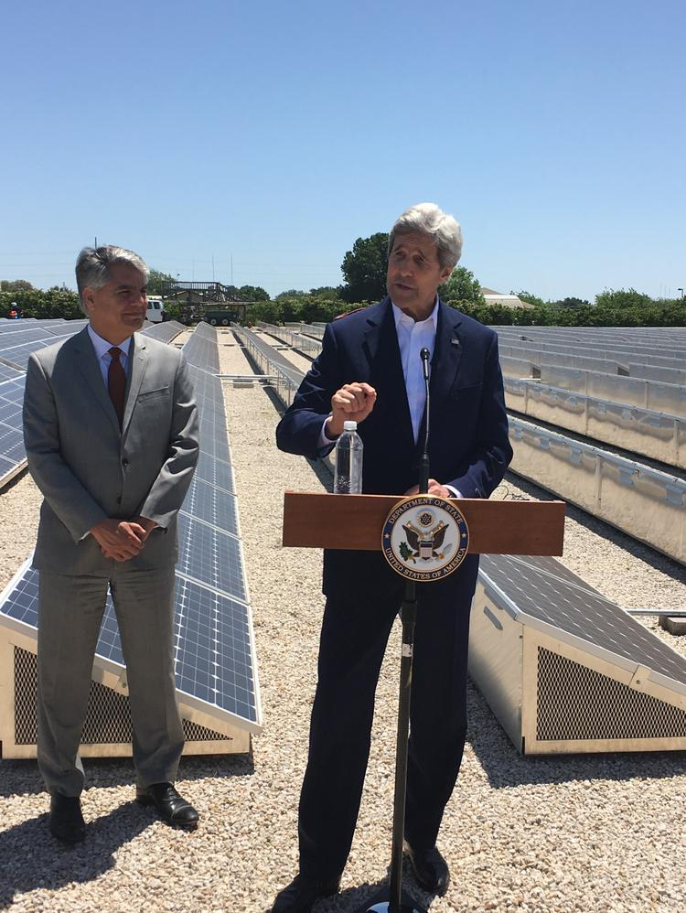 Secretary of State John Kerry met with clean energy experts at the J.J. Pickle Research Center on Wednesday. University of Texas President Gregory Fenves, left, also attended.