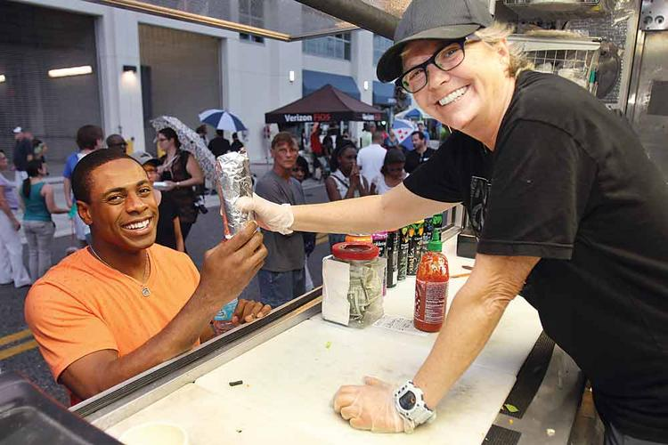 Tammy Young serves New York Yankees outfielder Curtis Granderson. He stopped by the Rollin' Zoinks food truck at a rally this summer.