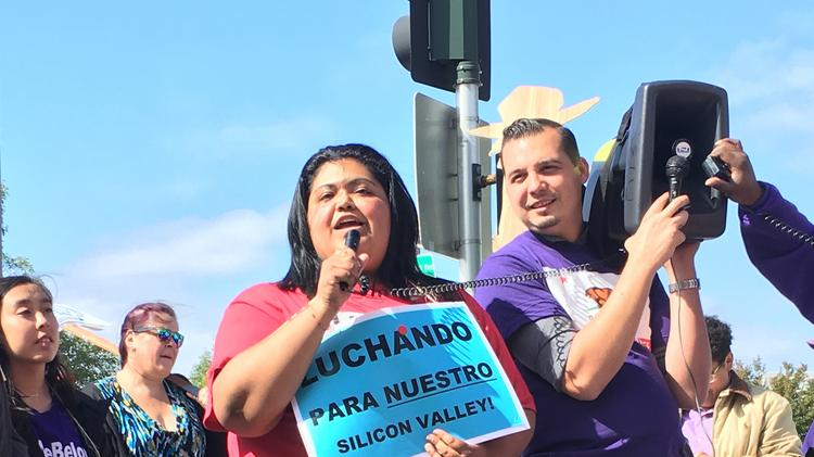 "Maria Guadalupe Guerrero, an Intel cafeteria worker who wants to unionize, addresses the crowd of demonstrators: ""I've had to deal with a lot of challenges in my life ... Working in the cafeteria is one of the worst. All of the pressure and discrimination against myself, how workers get treated isn't right."""
