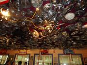 Chuy's has a car theme that runs throughout the restaurant, with one dining area that has a ceiling lined with hubcaps and rims of all sizes.