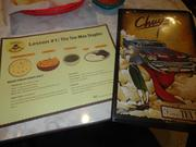 Chuy's menu and place mat help educate you on Tex-Mex staples.