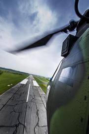 The view outside a Chinook as it passes over a runway on a media demonstation flight.