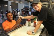 Tammy Young serves New York Yankees outfielder Curtis Granderson after he stopped by the Rollin' Zoinks food truck at a rally this summer.