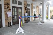The doorman and the ribbon to be cut, at the resort's entrance.