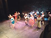 The New Century Follies burlesque group used smartphones as props in their opening dance number to help encourage the Folly Theater audience to use the interactive Center Screen app.