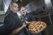 Fred Morgan, left, and Rico Cuomo are two of the three co-owners of Fired Pie. The company is opening three pizzerias this summer, and the owners said the biggest risk they are taking is with the Park Central Mall location.