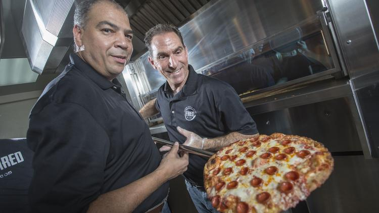 Fred Morgan, left, and Rico Cuomo are two of the three co-owners of Fired Pie. The company is opening a handful of new pizzerias to expand its footprint in the growing fast-casual pizza wars.