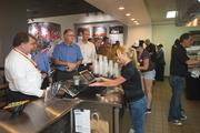 Lori Cuomo works the register as businesspeople gather for lunch at Fired Pie in Park Central Mall.