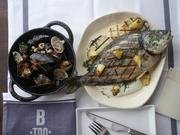 """Op de Graat Gegrilde vis Ostensaise, or whole fish 'ostendaise"""" with mussels and baby grey shrimp."""