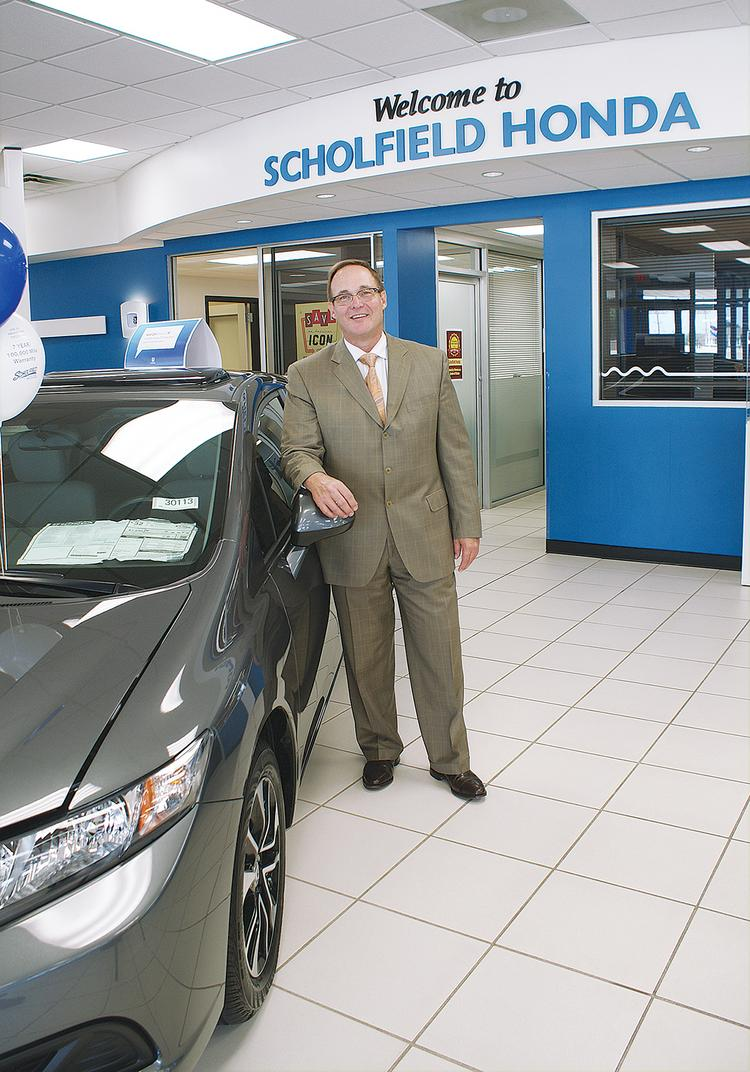 Roger Scholfield says sales at his Honda dealership are up about 14 percent so far in 2013.