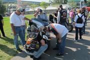 Harley-Davidson riders inspect the new 2014 motorcycles at the Summerfest grounds.