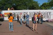 Harley-Davidson 110th anniversary visitors are encouraged to sign a large mural at the Summerfest grounds.