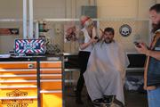 Visitors could get a haircut, beard trim and even a new tattoo at a booth on the Summerfest grounds.