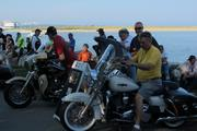 Visitors get a feel for the 2014 motorcycles parked on the lakefront.