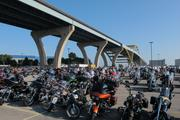 Motorcycles were lined up in the parking lots outside the Summerfest grounds Thursday.