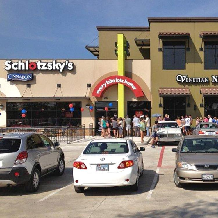 Now open! Crowds gather at the grand opening of the new Schlotzsky's at Rialto Village