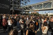 Riders crowd around the stage at the Harley-Davidson Museum for the final countdown for the start of the anniversary celebration.