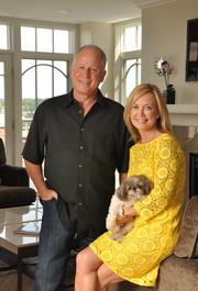 Bruce Lunsford (left), businessman and former Kentucky politician. Pictured with wife Jennifer McAdams and dog Jacques, at Park Place luxury condo in downtown Saratoga Springs. Box: E6. Price: $6,545