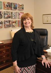 Laurie A. Cooper  Vice president and general counsel Cooper Hotels