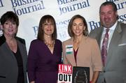 Candace Moody, chair of the Jacksonville Women's Business Center advisory board (left), stands next to leadership consultant Leslie Grossman, Women of Influence honoree Deborah Croft of The Bailey Group and Anthony Kurlas, managing director of the North Florida market for Merrill Lynch.