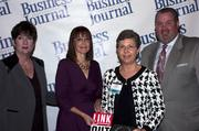 Candace Moody, chair of the Jacksonville Women's Business Center advisory board (left), stands next to leadership consultant Leslie Grossman, Women of Influence honoree Sherry Davidson of Davidson Realty and Anthony Kurlas, managing director of the North Florida market for Merrill Lynch.