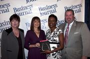 Candace Moody, chair of the Jacksonville Women's Business Center advisory board (left), stands next to leadership consultant Leslie Grossman, Women of Influence honoree Rosa Beckett of the Jacksonville Aviation Authority and Anthony Kurlas, managing director of the North Florida market for Merrill Lynch.
