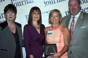 Candace Moody, chair of the Jacksonville Women's Business Center advisory board (left), stands next to leadership consultant Leslie Grossman, Women of Influence honoree Nancy Chartrand of The Chartrand Foundation and Anthony Kurlas, managing director of the North Florida market for Merrill Lynch.