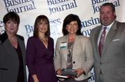 Candace Moody, chair of the Jacksonville Women's Business Center advisory board (left), stands next to leadership consultant Leslie Grossman, Women of Influence honoree Lori Day of EverBank and New Day Solutions and Anthony Kurlas, managing director of the North Florida market for Merrill Lynch.