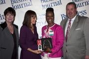 Candace Moody, chair of the Jacksonville Women's Business Center advisory board (left), stands next to leadership consultant Leslie Grossman, Women of Influence honoree Dr. Tra'Chella Johnson Foy of UF Health Jacksonville and Anthony Kurlas, managing director of the North Florida market for Merrill Lynch.