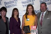 Candace Moody, chair of the Jacksonville Women's Business Center advisory board (left), stands next to leadership consultant Leslie Grossman, Women of Influence honoree Janet Herrick of Onsite Environmental Consulting and Anthony Kurlas, managing director of the North Florida market for Merrill Lynch.