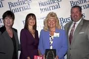 Candace Moody, chair of the Jacksonville Women's Business Center advisory board (left), stands next to leadership consultant Leslie Grossman, Women of Influence honoree Ann Huffty of Automatic Data Processing Inc. and Anthony Kurlas, managing director of the North Florida market for Merrill Lynch.