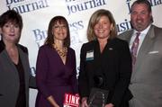 Candace Moody, chair of the Jacksonville Women's Business Center advisory board (left), stands next to leadership consultant Leslie Grossman, Women of Influence honoree Shannon Italia of the University of North Florida and Anthony Kurlas, managing director of the North Florida market for Merrill Lynch.