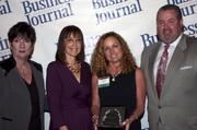 Candace Moody, chair of the Jacksonville Women's Business Center advisory board (left), stands next to leadership consultant Leslie Grossman, Women of Influence honoree Deborah McDowell of Seaonus and Anthony Kurlas, managing director of the North Florida market for Merrill Lynch.