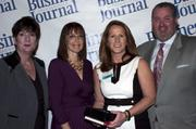 Candace Moody, chair of the Jacksonville Women's Business Center advisory board (left), stands next to leadership consultant Leslie Grossman, Women of Influence honoree Leigh Mills of Compass Consulting Group and Anthony Kurlas, managing director of the North Florida market for Merrill Lynch.