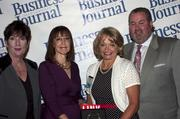 Candace Moody, chair of the Jacksonville Women's Business Center advisory board (left), stands next to leadership consultant Leslie Grossman, Women of Influence honoree Kathryn Murphy of Comfort Keepers and Anthony Kurlas, managing director of the North Florida market for Merrill Lynch.
