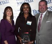 Leadership consultant Leslie Grossman (left), stands next to Women of Influence honoree Lisa Moore of IBM and Anthony Kurlas, managing director of the North Florida market for Merrill Lynch.