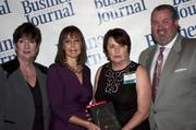 Candace Moody, chair of the Jacksonville Women's Business Center advisory board (left), stands next to leadership consultant Leslie Grossman, Women of Influence honoree Mary Kay O'Rourke of Habitat for Humanity of Jacksonville and Anthony Kurlas, managing director of the North Florida market for Merrill Lynch.