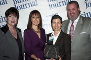 Candace Moody, chair of the Jacksonville Women's Business Center advisory board (left), stands next to leadership consultant Leslie Grossman, Women of Influence honoree Melanie Patz of United Way of Northeast Florida and Anthony Kurlas, managing director of the North Florida market for Merrill Lynch.