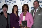 Candace Moody, chair of the Jacksonville Women's Business Center advisory board (left), stands next to leadership consultant Leslie Grossman, Women of Influence honoree Ava Parker, CEO of Linking Solutions and a member of the Jacksonville Transportation Authority board of directors, and Anthony Kurlas, managing director of the North Florida market for Merrill Lynch.