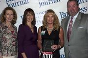 Sandy Bartow, president of the Jax Chamber Foundation (left), stands next to leadership consultant Leslie Grossman, Women of Influence honoree Fran Pepis of Colliers International Northeast Florida and Anthony Kurlas, managing director of the North Florida market for Merrill Lynch.