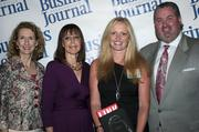 Sandy Bartow, president of the Jax Chamber Foundation (left), stands next to leadership consultant Leslie Grossman, Women of Influence honoree Yolande Piazza of Citi and Anthony Kurlas, managing director of the North Florida market for Merrill Lynch.