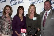 Sandy Bartow, president of the Jax Chamber Foundation (left), stands next to leadership consultant Leslie Grossman, Women of Influence honoree Mary Rawlins of Firehouse Subs and Anthony Kurlas, managing director of the North Florida market for Merrill Lynch.